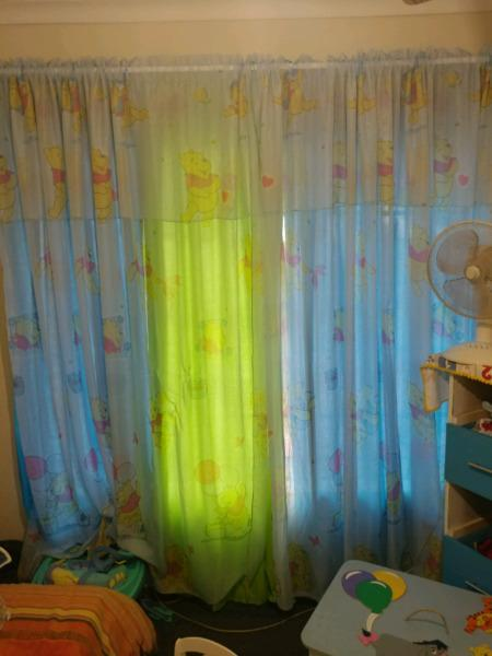 Winnie the pooh baby room with matching curtains