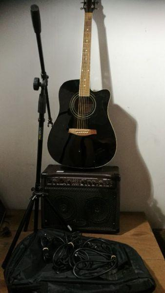 Ibanez V72ECE acoustic electric guitar. Laney L35C amp. Bag. Mic stand. Built in tuner. Pre amp