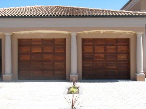 Single and double meranti garage doors in Arcadia
