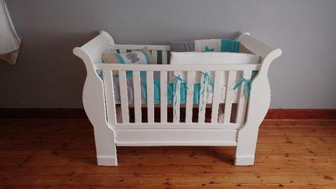 Sleigh cot converts to toddler bed
