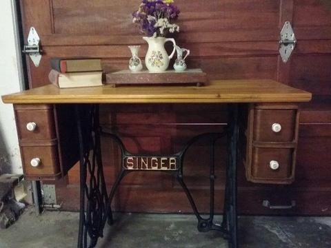 Antique Singer Cast Iron table repurposed for multiple uses to enhance any room